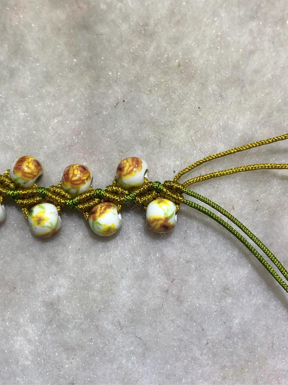 中国结论坛 陶瓷珠蕾丝手链。  图文教程区 144845t29tt1atqtt54krp