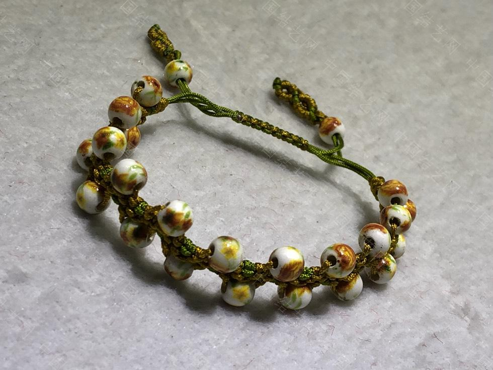 中国结论坛 陶瓷珠蕾丝手链。  图文教程区 144851wcjuysu1jppicbps