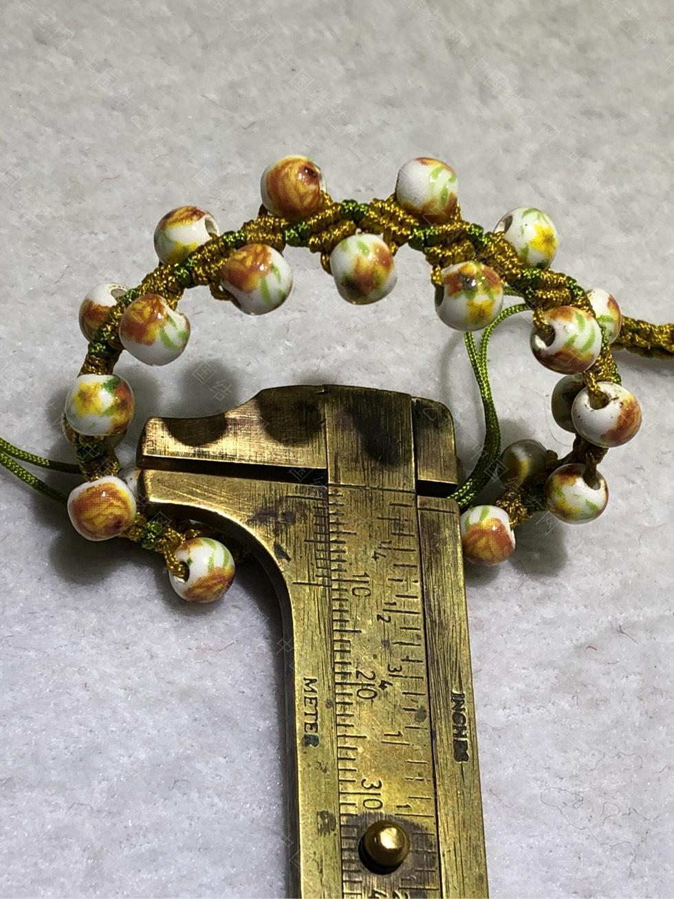 中国结论坛 陶瓷珠蕾丝手链。  图文教程区 144854m6h1hyyynr5h1hg5