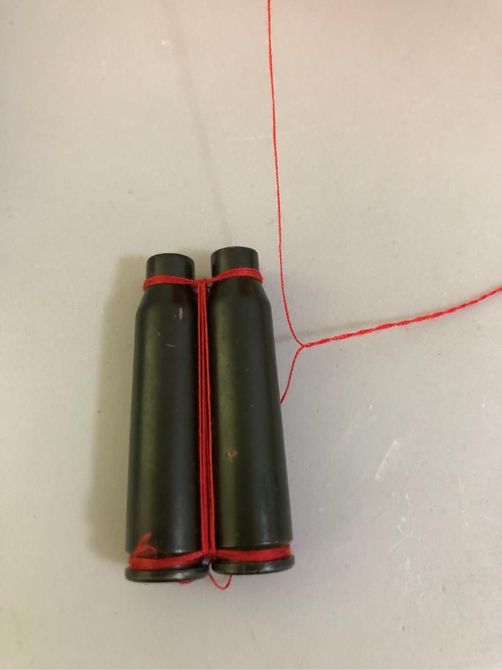 子弹壳红绳编织图解,细绳绑的子弹壳工艺品缠绕方法