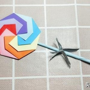 棒棒糖折法步骤图解,简单手工折纸折棒棒糖方法教程